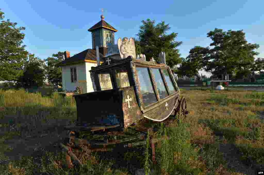 An old hearse is pictured at a historic cemetery in Sulina, Romania. (AFP/Daniel Mihailescu)