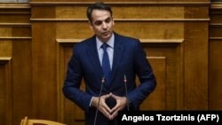 New Democracy party leader Kyriakos Mitsotakis speaks during a parliamentary session in Athens on June 14.