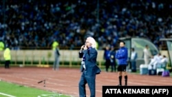 Esteqlal's German head coach Winfried Schafer yells instructions to his players during the AFC Asian Champions League group D football match on March 12, 2018, at the Azadi Stadium in Tehran.