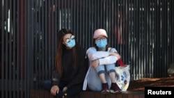 Žene sa zaštitnim maskama u Sidneju, Australija, 18 mart 2020.
