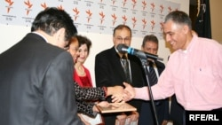 Amanullah Amirzai (far right) receives an award at RFE/RL, Czech Republic on February 2, 2007.