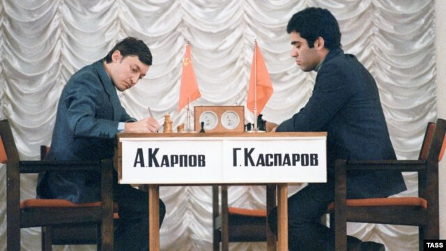 Garry Kasparov (right) the enfant terrible of Soviet chess who in 1985 dethroned the Kremlin's favorite player, Anatoly Karpov (left), squaring off against Karpov in Moscow in 1984.