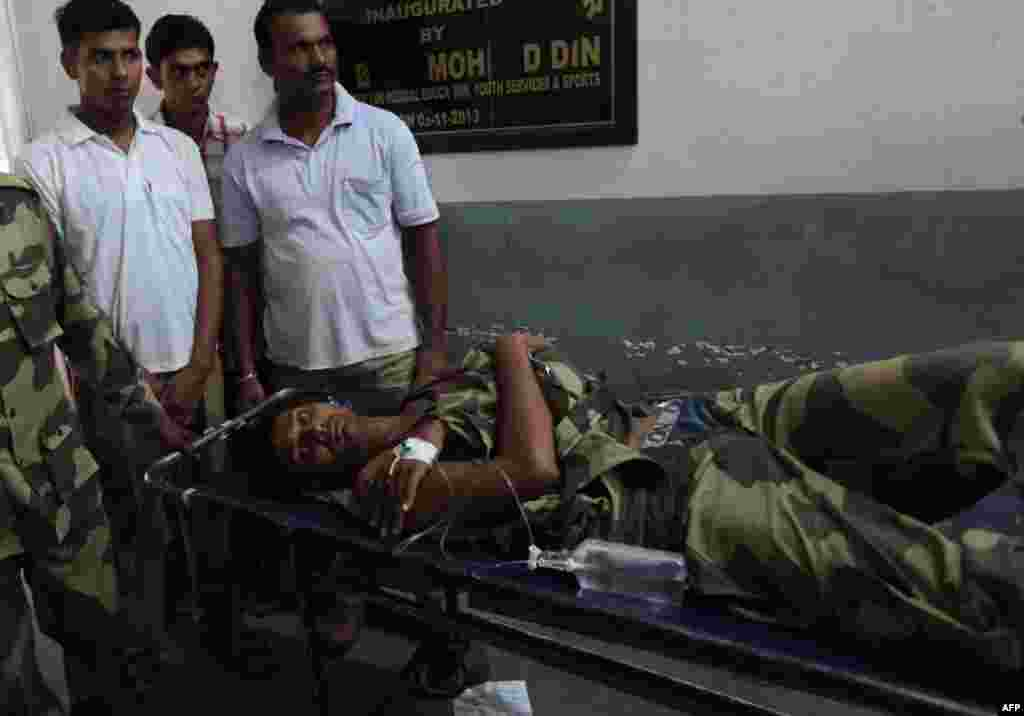 An Indian border guard is brought to a hospital in Jammu, in Indian-controlled Kashmir, on October 9. The Indian authorities said he was wounded during a cross-border exchange with Pakistani soldiers.