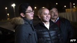 Kazakh opposition figure and oligarch Mukhtar Ablyazov, center, poses with his son Madiya and his brother-in-law after being released from the Fleury-Merogis jail, in Fleury-Merogis, near Paris, on December 9.