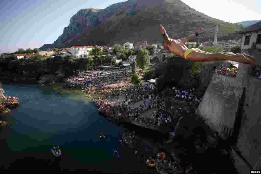 Diver Lorens Listo jumps from the center of Mostar's Stari Most, or Old Bridge. Diving competitions have been held here since the bridge was built 447 years ago, although the current formal competition dates back only to 1968.