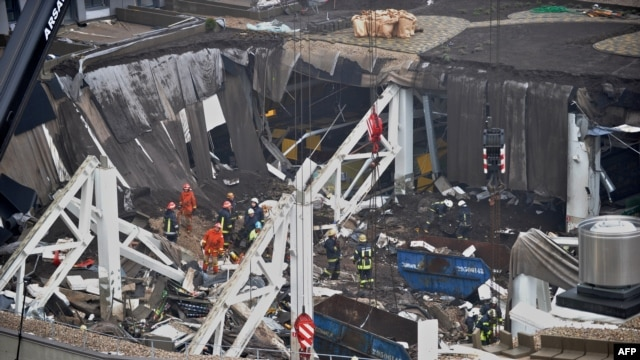 Rescuers search for survivors at the site where the Maxima supermarket roof collapsed in Riga, leaving dozens dead.