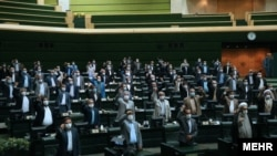 Parliament MPs listen to the speech of Supreme Leader, Ayatollah Ali Khamenei, on Sunday, July 12, 2020.