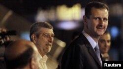 Башар Асад (cправа), Куба, 27 июня 2010