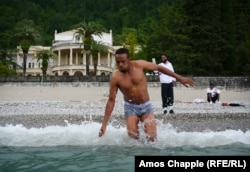 Samaliland player Abbikarim Hirsi takes a dip in the Black Sea on his first trip away from his homeland.