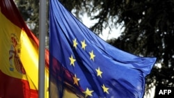 Spain -- The Spanish flag and the EU flag fly in front of the Moncloa palace in Madrid, 08Jan2010