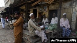 Bengali immigrants living in Pakistan gather at a market in Karachi on September 17.