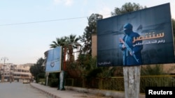 Islamic State billboards are seen along a street in Raqqa, the group's de facto capital in Syria.