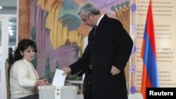 Armenian President Serzh Sarkisin casts his ballot during a referendum on constitutional changes in Yerevan on December 6. The proposals were passed with a large majority, but opposition groups say the vote was rigged.