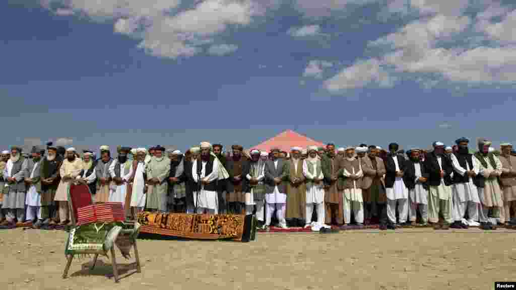 Officials and mourners perform funeral prayers over the coffin of former Taliban minister Maulvi Arsala Rahmani, a senior member of the Afghan High Peace Council, in Kabul. (Reuters/Mohammad Ismail)