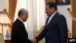 Իրանի Անվտանգության գերագույն խորհրդի գլխավոր քարտուղար Ալի Շամխանին (աջից) Թեհրանում ընդունում է ԱԷՄԳ-ի գլխավոր քարտուղար Յուկիա Ամանոյին, 2-ը հուլիսի, 2015թ.