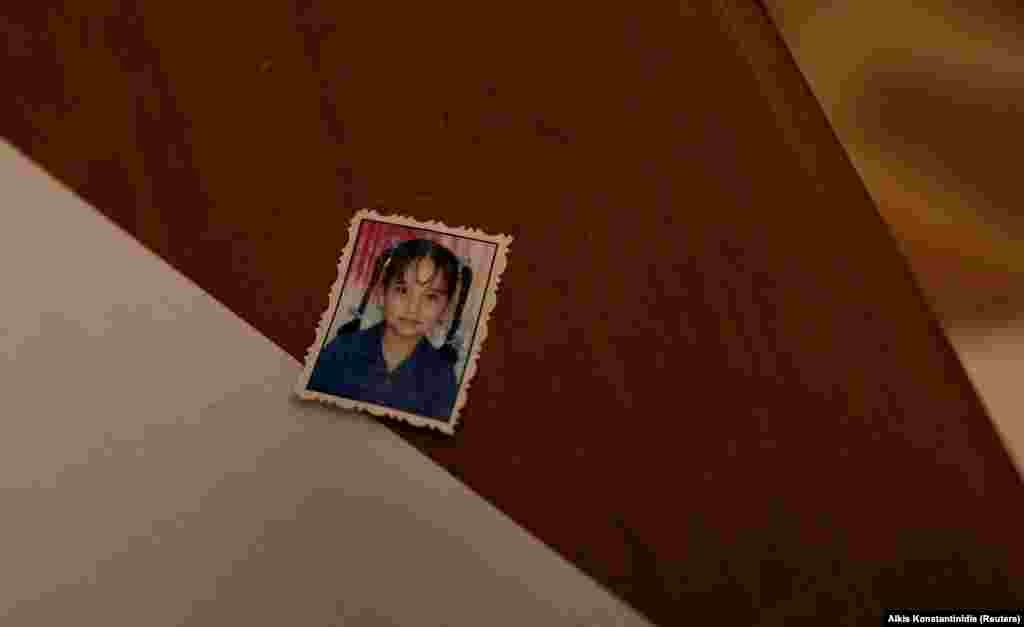 The photo of an unidentified girl is placed on a desk inside the compound.