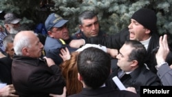 Armenia - Riot police and opposition activists scuffle in Yerevan's Liberty Square, 14Mar2013.