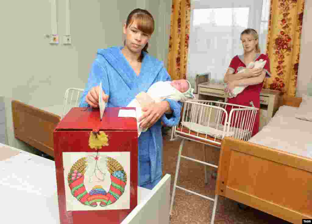 A woman casts her vote at a maternity ward in Mogilev.