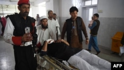 FILE: Pakistani medics move an injured security personnel for a treatment at a hospital in Peshawar on February 15.