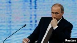 Президент России Владимир Путин во время Петербургского международного экономического форума. 17 июня 2016 года.