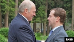 Russian President Dmitry Medvedev (right) meets with his Belarus counterpart Alyaksandr Lukashenka in Gorky on June 11.