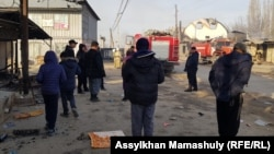Locals inspect damage in the Kazakh village of Masanchi after ethnic clahsed erupted there at the weekend.