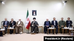 IRAN -- Iranian President Hassan Rohani and his cabinet meet the Supreme Leader Ayatollah Ali Khamenei (center), in Tehran, August 29, 2018