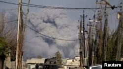 Smoke rises after an air strike in western Mosul on March 10, 2017.