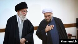 Iran -- Iran's Supreme Leader Ali Khamenei (L) and Ahmad Marvi, his new appointee as the custodian of Astan Quds Razavi.