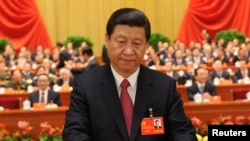 Қытай коммунистік партиясының бас хатшысы Си Цзиньпин. Пекин, 14 қараша 2012 жыл.