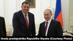 The president of the Bosnian Serb entity Republika Srpska, Milorad Dodik (left), and Russian President Vladimir Putin meet near Moscow on September 22.