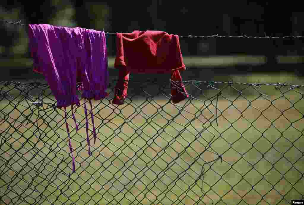 Clothes are hung up to dry on a fence at the Bogovadja asylum center.