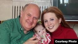 U.S. citizens Frank and Gabrielle Shimkus with their prospective Kyrgyz adoptee Azamat