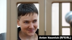 Ukrainian military pilot Nadia Savchenko is seen inside a defendant's cage as she attends a court hearing in the Russian city of Donetsk last week,