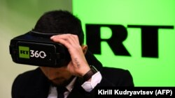 RUSSIA -- A man tries on a VR goggles at the stand of Russia's state-controlled broadcaster RT during the 10th Russian Internet Week in Moscow, November 1, 2017