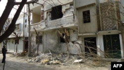 A damaged building in the Bab Amr neighborhood of the flashpoint city of Homs shows signs of the violence there.