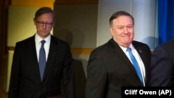 File Photo:Secretary of State Mike Pompeo, right, followed by Brian Hook, special representative for Iran, walk to a podium to announce the creation of the Iran Action Group at the State Department, in Washington, Thursday, Aug. 16, 2018.