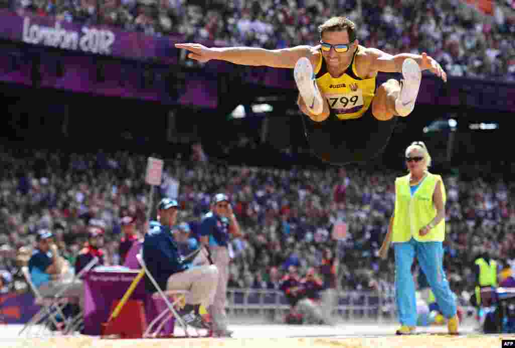 Ukraine's Ruslan Katyshev competes in the men's triple-jump final.