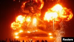 "A ""man"" is burned toward the close of the Burning Man 2013 arts and music festival on August 31."