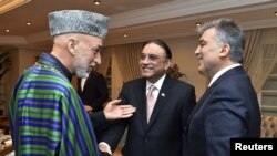 Presidents Hamid Karzai of Afghanistan, Asif Ali Zardari of Pakistan, and Abdullah Gul of Turkey (left to right) chat during a dinner at the Presidential Palace of Cankaya in Ankara.