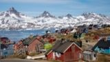 GREENLAND -- Snow covered mountains rise above the harbour and town of Tasiilaq, Greenland, June 15, 2018. REUTERS/Lucas Jackson/File Photo