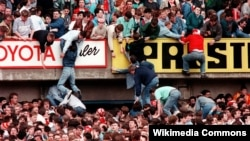 Liverpool fans trying to escape severe overcrowding during the severe crushing at Hillsborough stadium in Sheffield England during an FA Cup semi-final football match between Liverpool and Nottingham Forest. 1989
