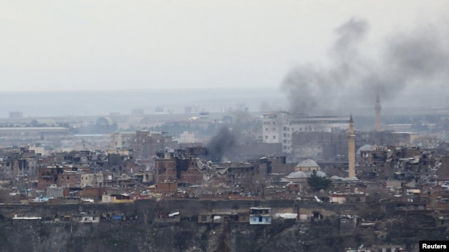 Smoke rises after clashes between Turkish security forces and Kurdish militants in the Sur district of Diyarbakir on February 11.