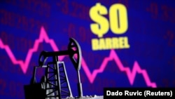 "A 3D-printed oil pump jack is seen in front of a displayed stock graph and ""$0 Barrel"" words - generic."