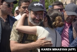 Opposition leader Nikol Pashinian is embraced by a supporter as he takes part in a rally in Yerevan on May 2.