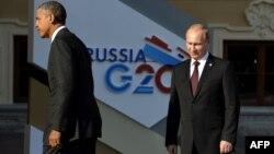 """Президент США Барак Обама (слева) и президент России Владимир Путин на саммите """"Большой двадцатки"""". Санкт-Петербург, 5 сентября 2013 года."""