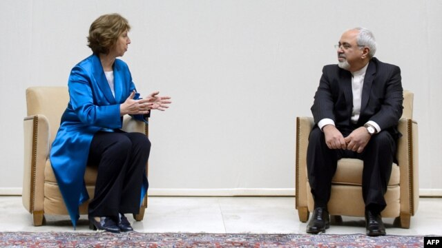 EU High Representative for Foreign Affairs Catherine Ashton (left) speaks with Iranian Foreign Minister Mohammad Javad Zarif at the start of two days of closed-door nuclear talks in Geneva.