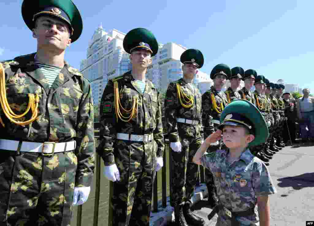 Belarusian border guards celebrate their agency's day in Minsk on May 28. (AFP/Viktor Drachev)