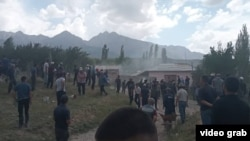 Villagers started throwing stones at each other before several houses on each side were set on fire on May 31.