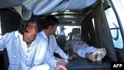 Pakistani relatives transport the body of a blast victim at a hospital after a bomb explosion at a market in Parachinar, the capital of Kurram tribal district, on December 13.